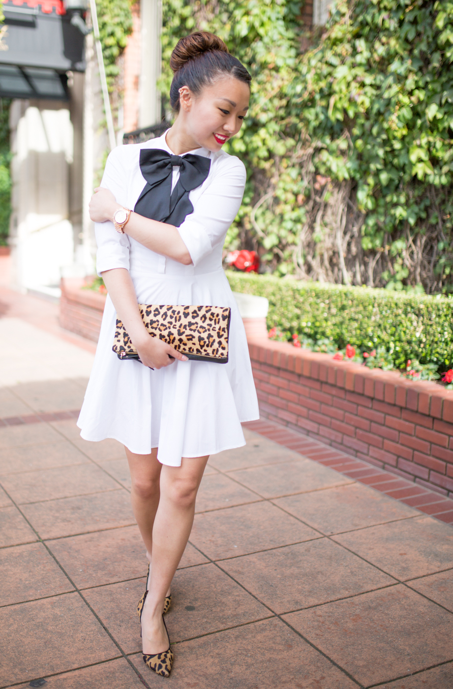 Leopard pumps and clutch | via The Chic Diary