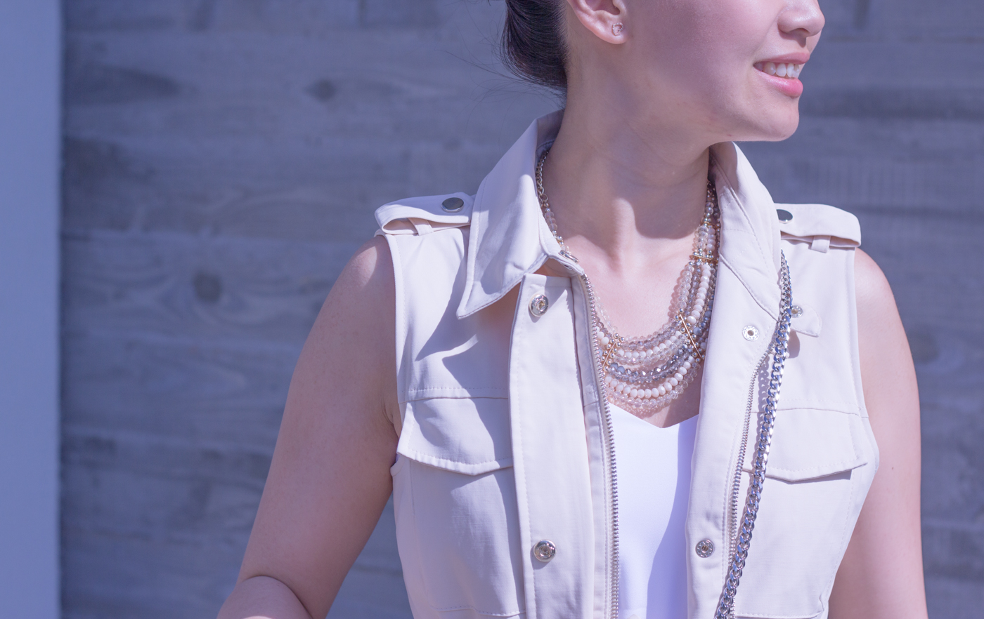 Statement necklace and sleeveless trench   via The Chic Diary
