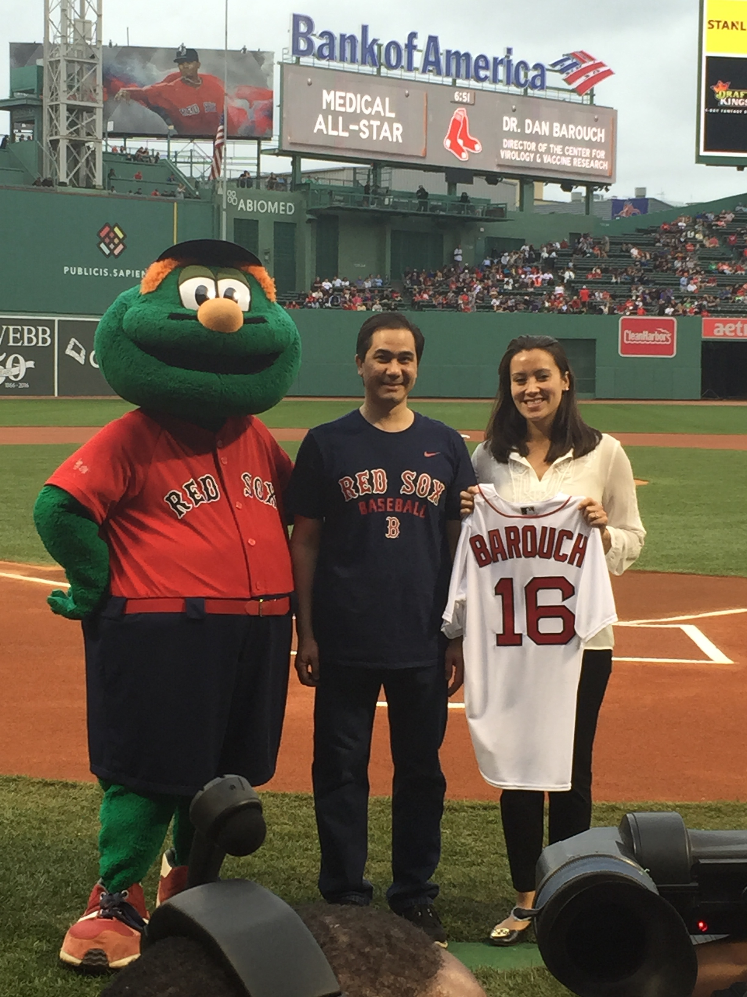 Dr. Barouch and a Red Sox official pose with Wally for a photo opp after being honored as a Medical All-Star.