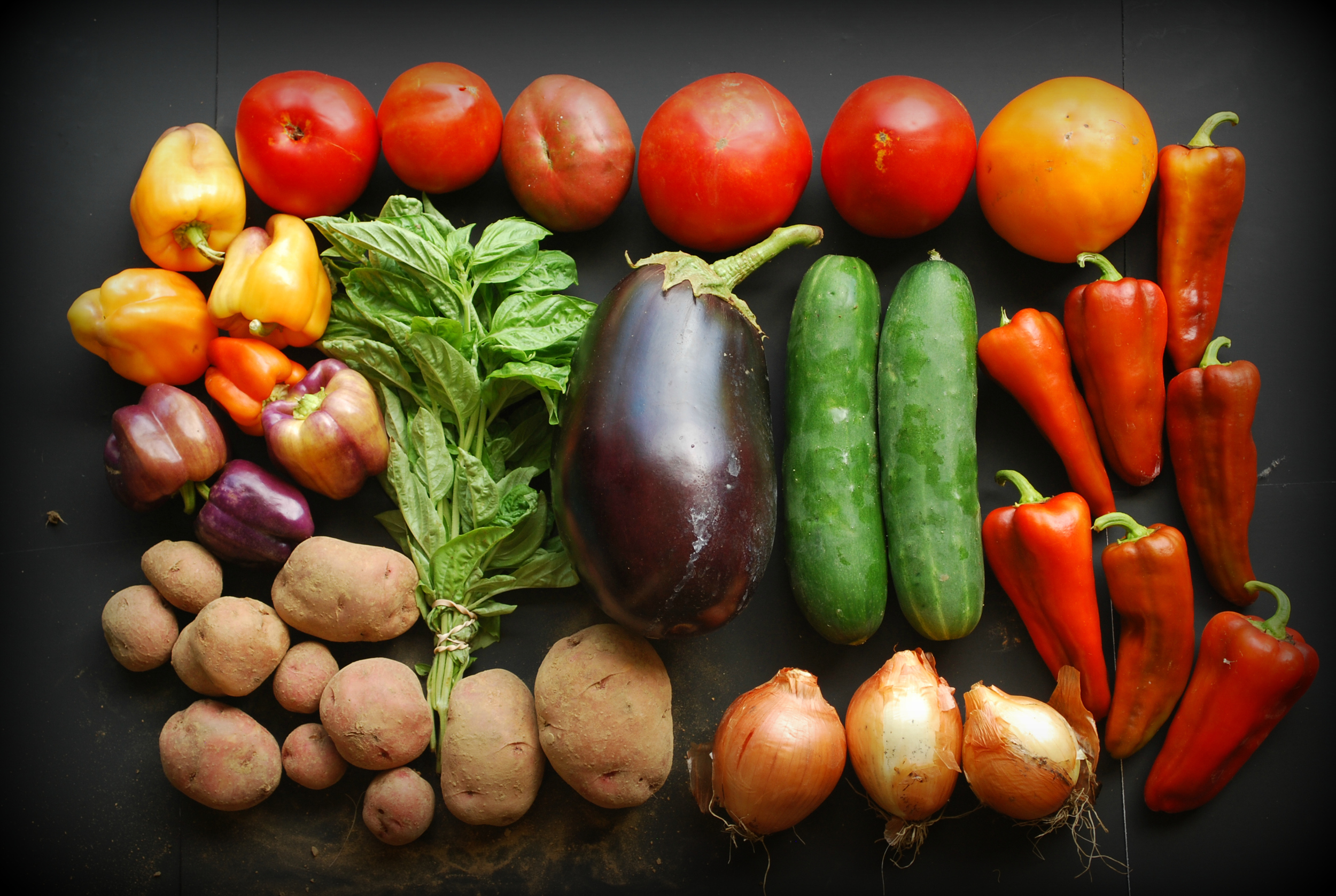 Potatoes, slicing tomatoes, Italian roasting peppers, yellow onions, cucumber, eggplant, bell peppers, basil
