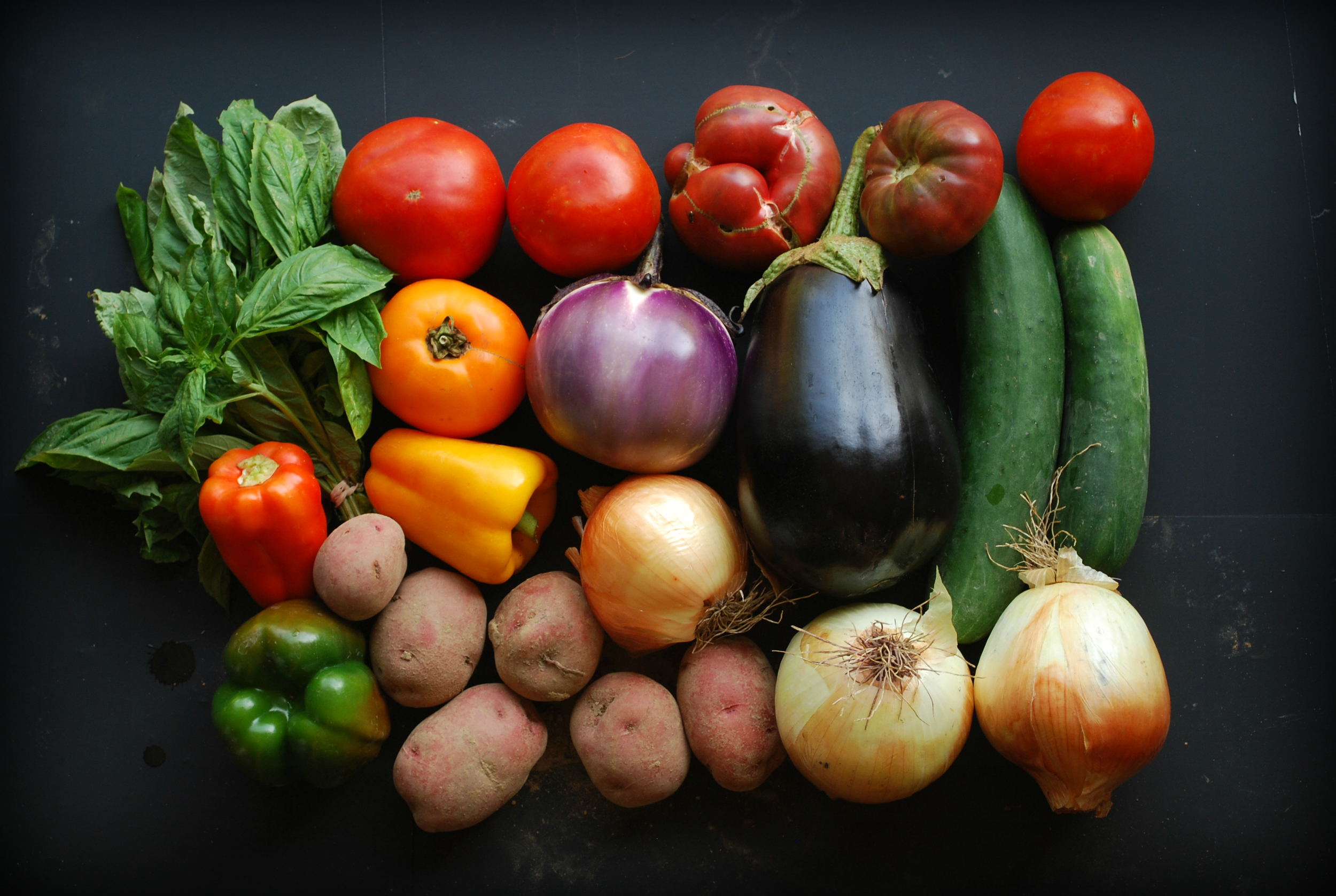 Your Week 14 Share: Basil, bell peppers, potatoes, heirloom tomatoes, slicing tomatoes, yellow onions, eggplant, cucumber.