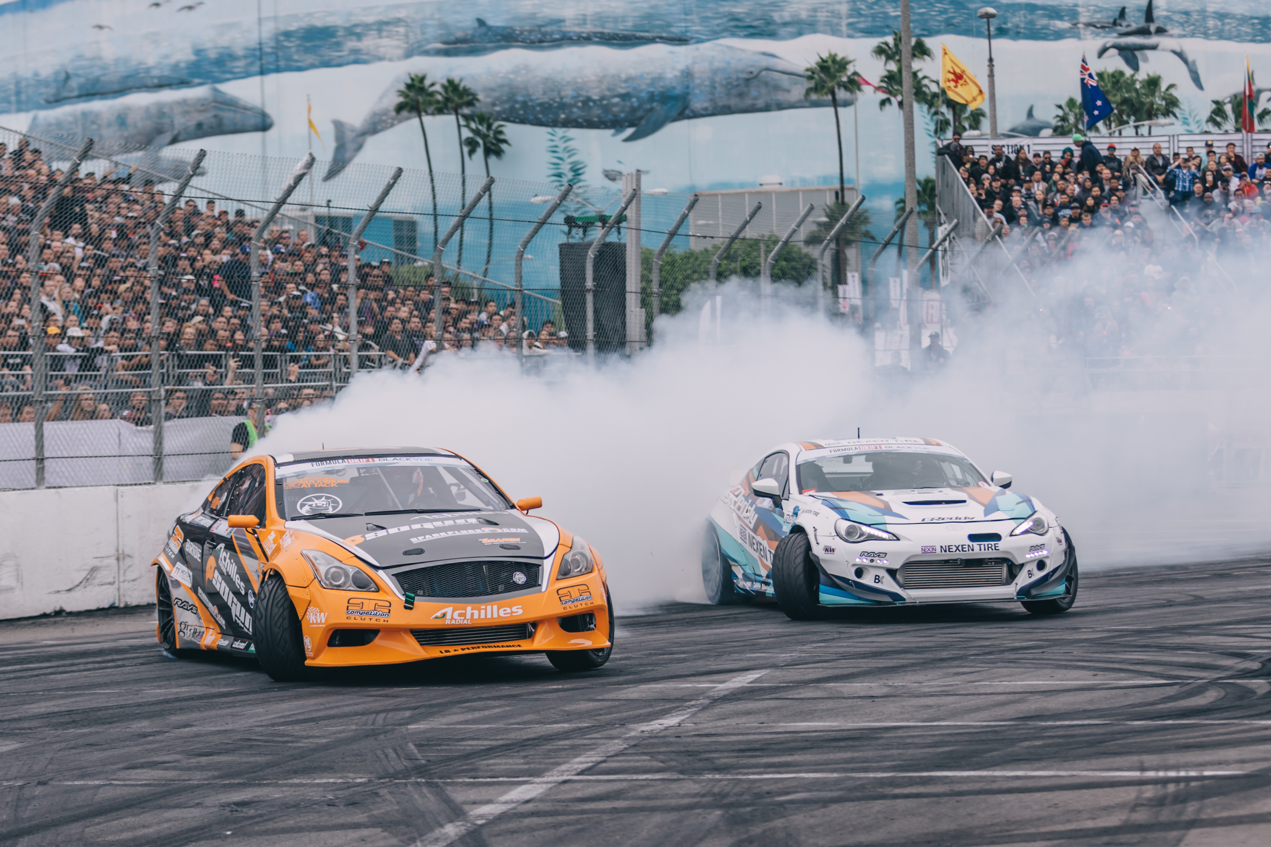 Charles Ng in the Infiniti G37 Liberty Walk (left) battling it out with Ken Gushi Rocket Bunny Scion FR-S (Right) in the Top 16 Run on the tracks of Long Beach, California.