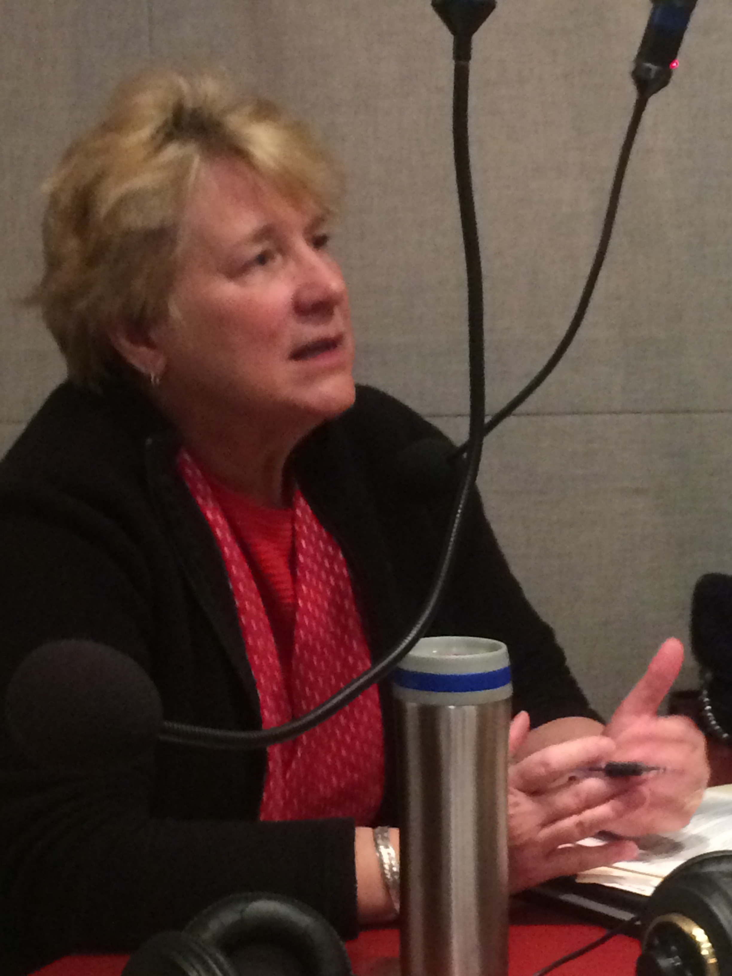 "Former Boulder mayor Leslie Durgin at KGNU studio discussing Back Porch group recommendations including ""Innovate for Impact"""