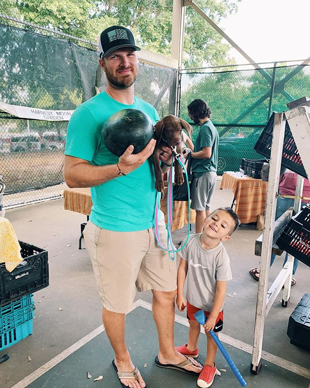 🍉 🐶  my handsome boys & Jolene. Trying to shop with her is impossible, everyone wants to pet the puppy! Especially when your husband is cute too! 😘 #quittalkingkeepwalking . . . . . #athensfarmersmarket#farmersmarket#puppies#chocolatelabpuppy#chocolatelab#coastalleashes#farmtotable#boymom#jolene🐶💛#🐶