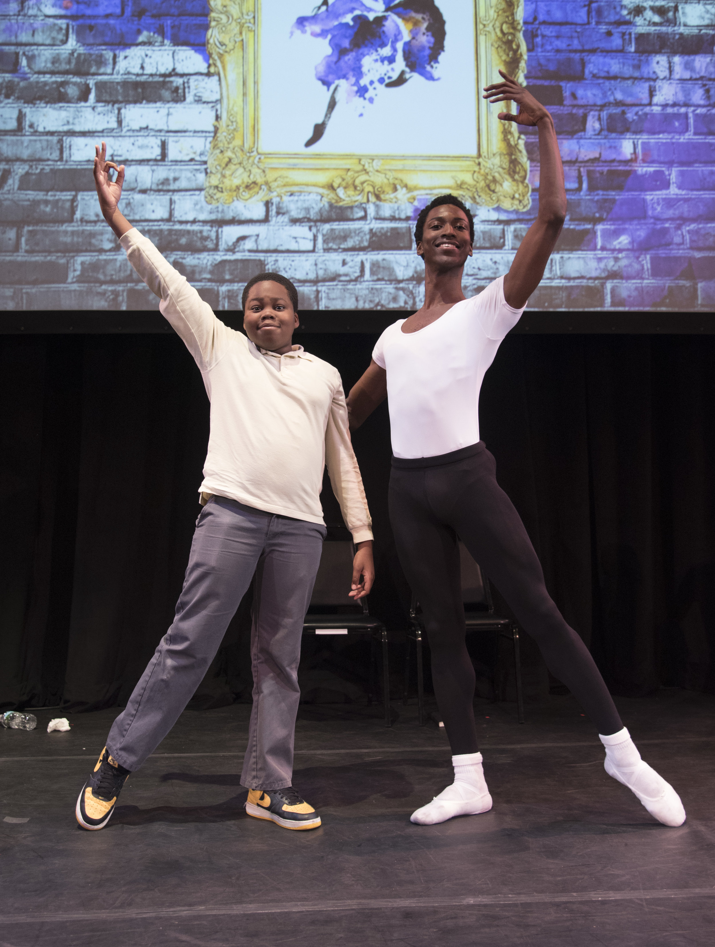 The Black Iris Project  dancer Vincent Farley teaches P.S. 189 student Ife Akinnibosun a few ballet moves.