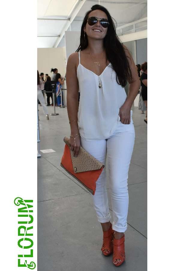 White on white with splashes of orange spotted on  Cayla Birk