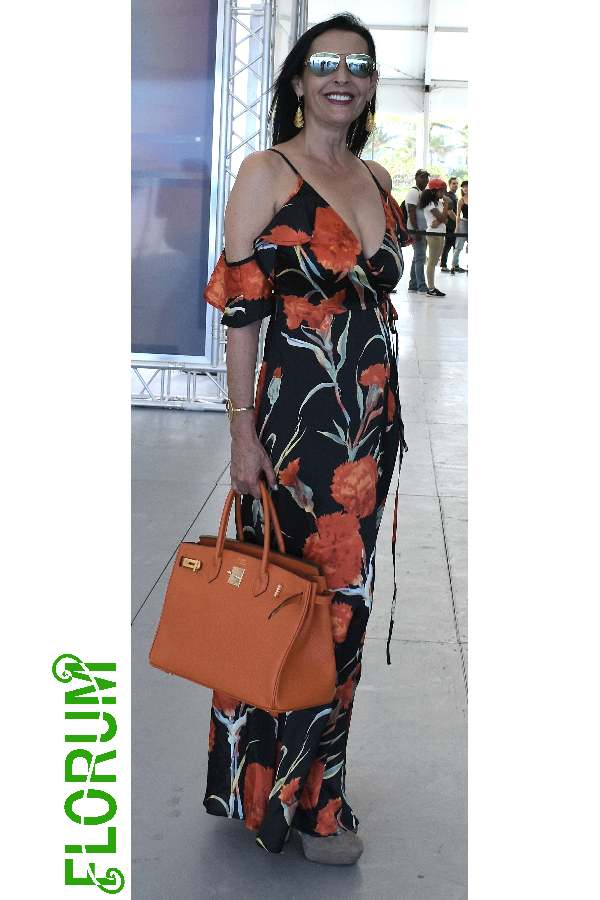 Printed maxi dress with pops of orange spotted on  Ghada Dergham