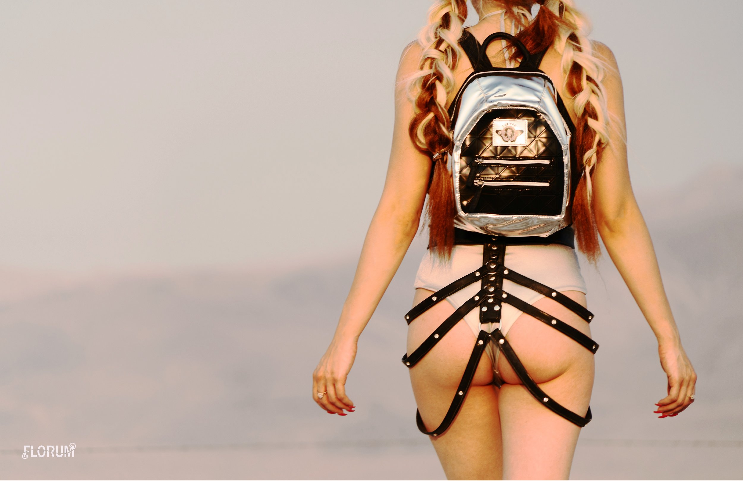 """ethically made    silver her. one piece swimsuit   THE LIDO $129  shop here      handcrafted vegan  """"isra"""" caged layered belt  THE GLOW STROBE  $110    shop here       vegan festival hydration pack  black tar mini   DAN PAK  $40  shop here"""