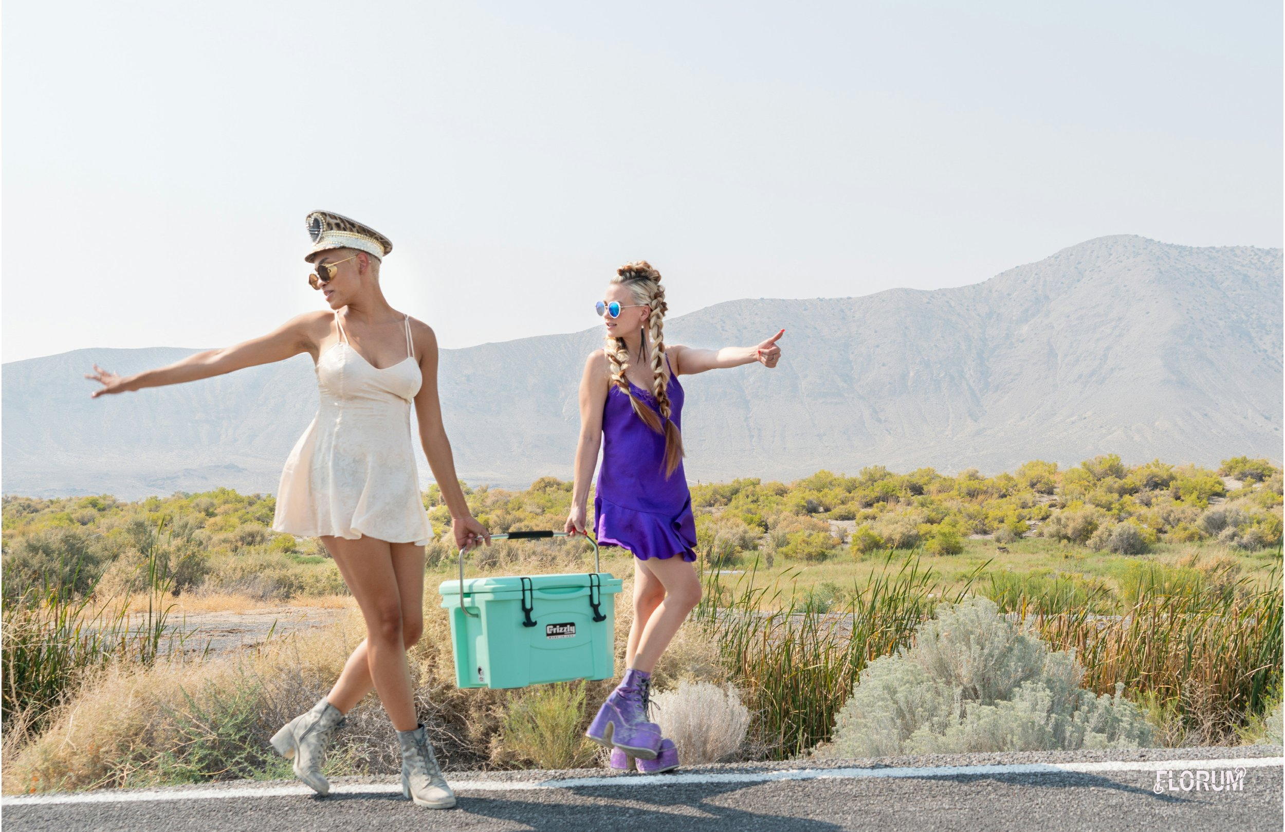 Both Yana and Kylee are wearing vintage Victoria Secret nightgowns. One of my favorite things to search for whenever entering a curated vintage shop or a charity shop is silk nightgowns. As you can see these vintage silk nightgowns were the perfect outfit to sport on the hot journey through the town and desert of Gerlach, Nevada on the way to Black Rock City.