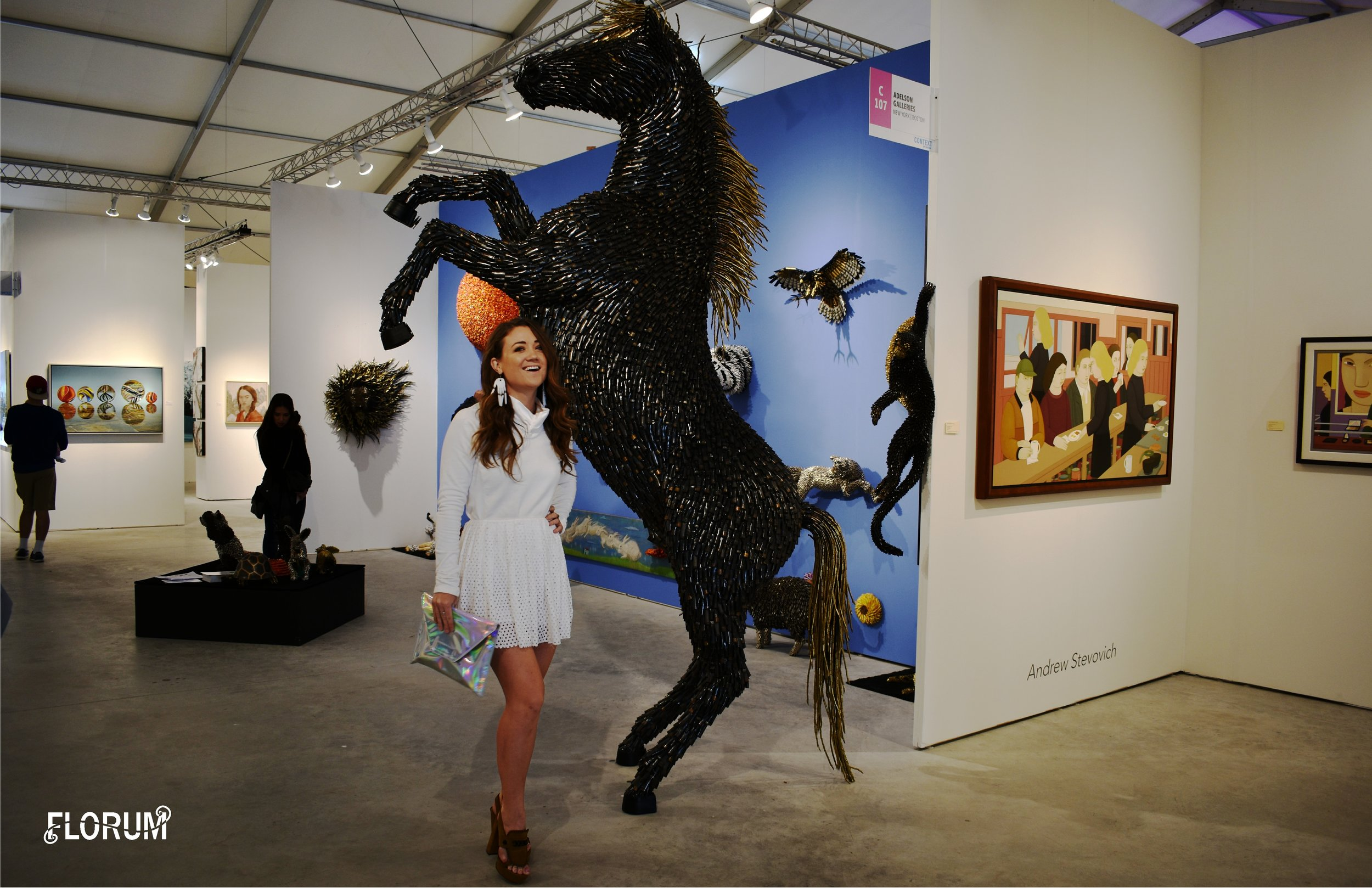 ART Miami 2017  'Horse' by Colombian artist Federico Uribe that was designed in 2016  and entirely made of bullet shells.  Noelle Lynne wearing a white sweater by ethical Canadian brand  Fig Clothing , skirt by  Alexander Mcqueen , thrifted clutch,  white finger frolics earrings by REDGREGOR that are made of upcycled plexiglas , and  sustainable luxury shoes by Viktor & Rolf from online consignment shop the Real Real (Click  HERE  to get $25 off your first purchase on The Real Real)