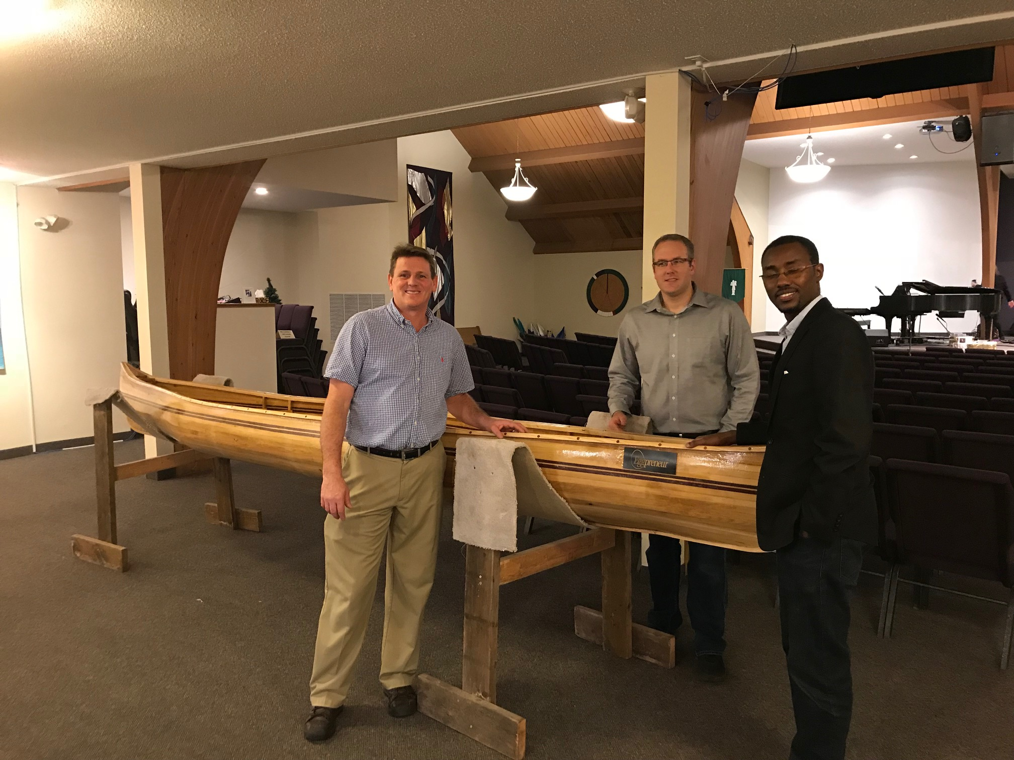Matt with two of the men who built the canoe.