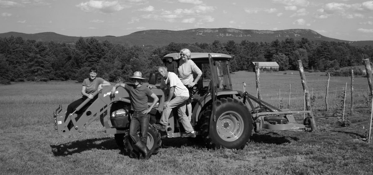 Michelle Kersbergen, Ian Modestow, Ed Hamel and Mary Hamel pose on the vineyard tractor. Photo courtesy Black Birch Vineyard.
