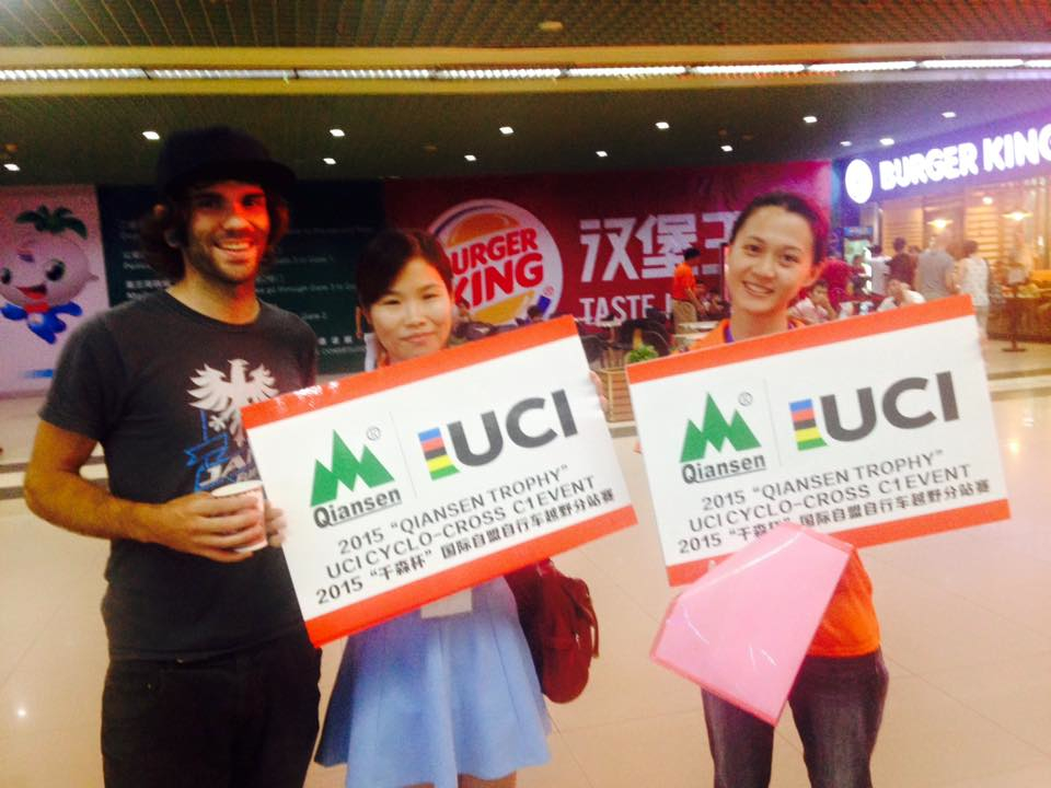 Chris Neisen was greeted by Chinese race ambassadors at the airport near Changsha.
