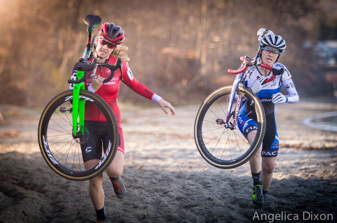 Jena Greaser and Emma White (Cyclocrossworld.com) ran through the sand during Sunday's NBX Gran Prix. Photo by Angelica Dixon.