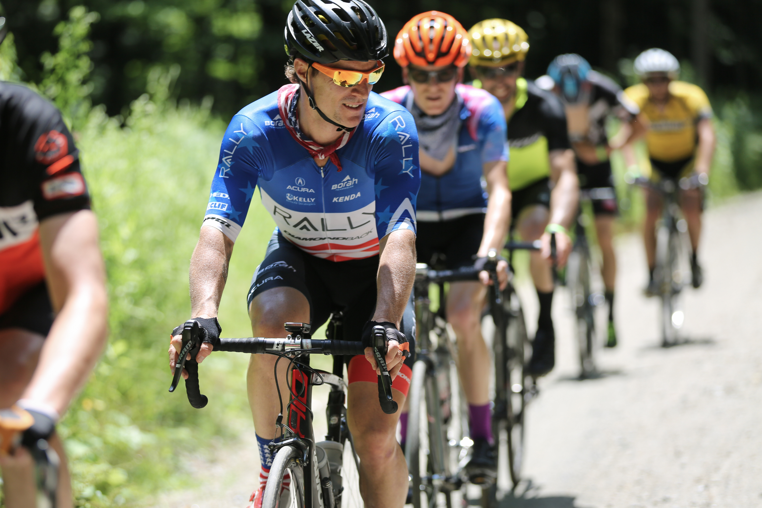 Cyclists ride the Fundo's gravel roads with U.S. National Criterium Champion Brad Huff. Photo by Meg McMahon.
