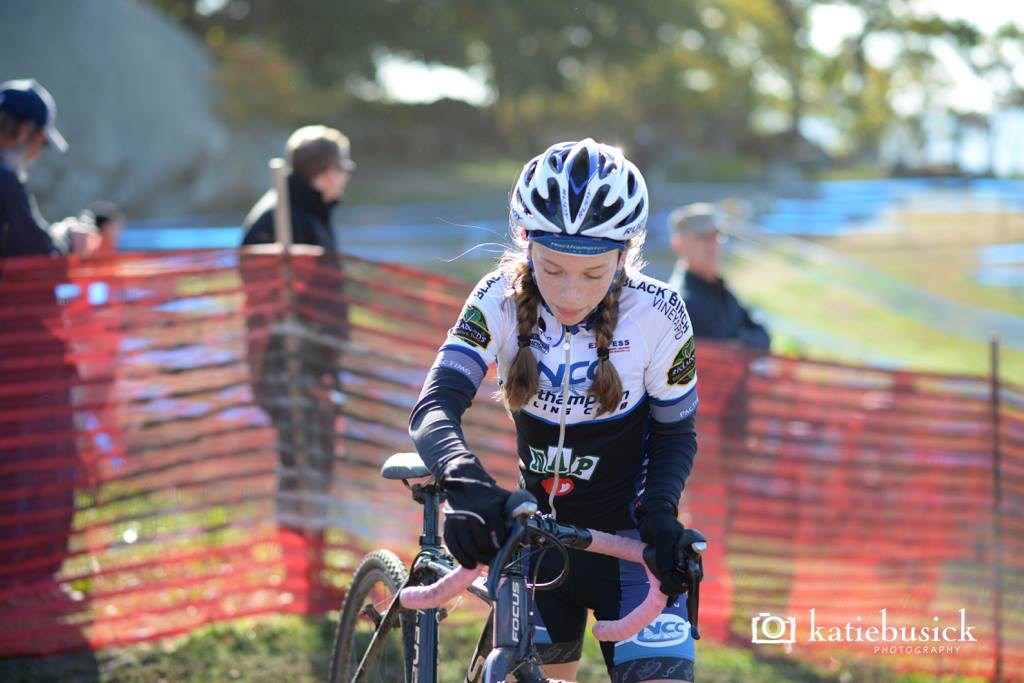 Two-time JAM Fund Grand Recipient Mira Fowler runs the hill at Gran Prix of Gloucester and gets 3rd place in the junior women's 9-14 category. Photo by Katie Busick Photography.
