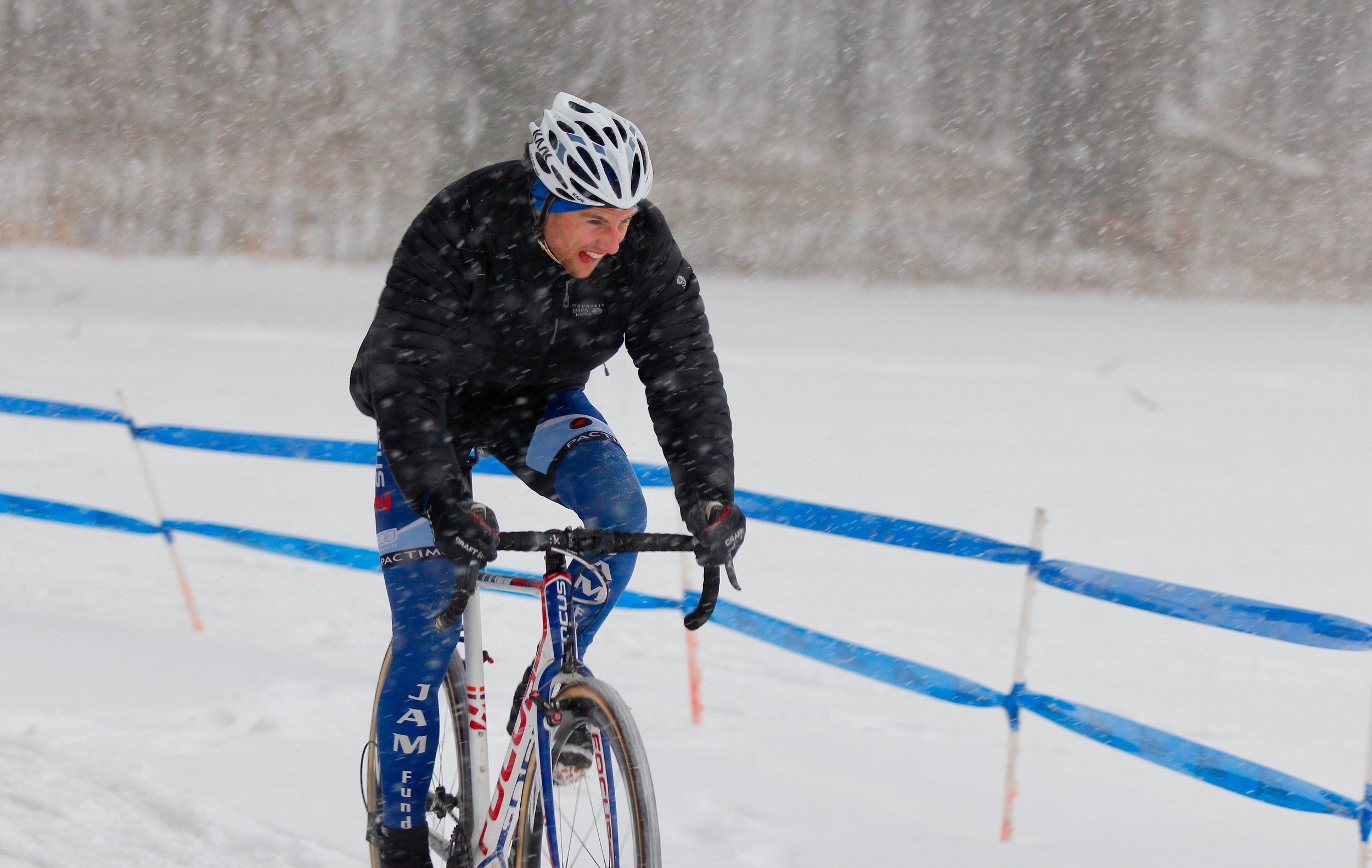 Jack Kisseberth rode the course on Saturday evening in advance of Sunday's championship race. Weather conditions were harsh. The snow was blowing sideways making visibility difficult. The snow is expected to stop before his elite race. Photo by Vicky Sama