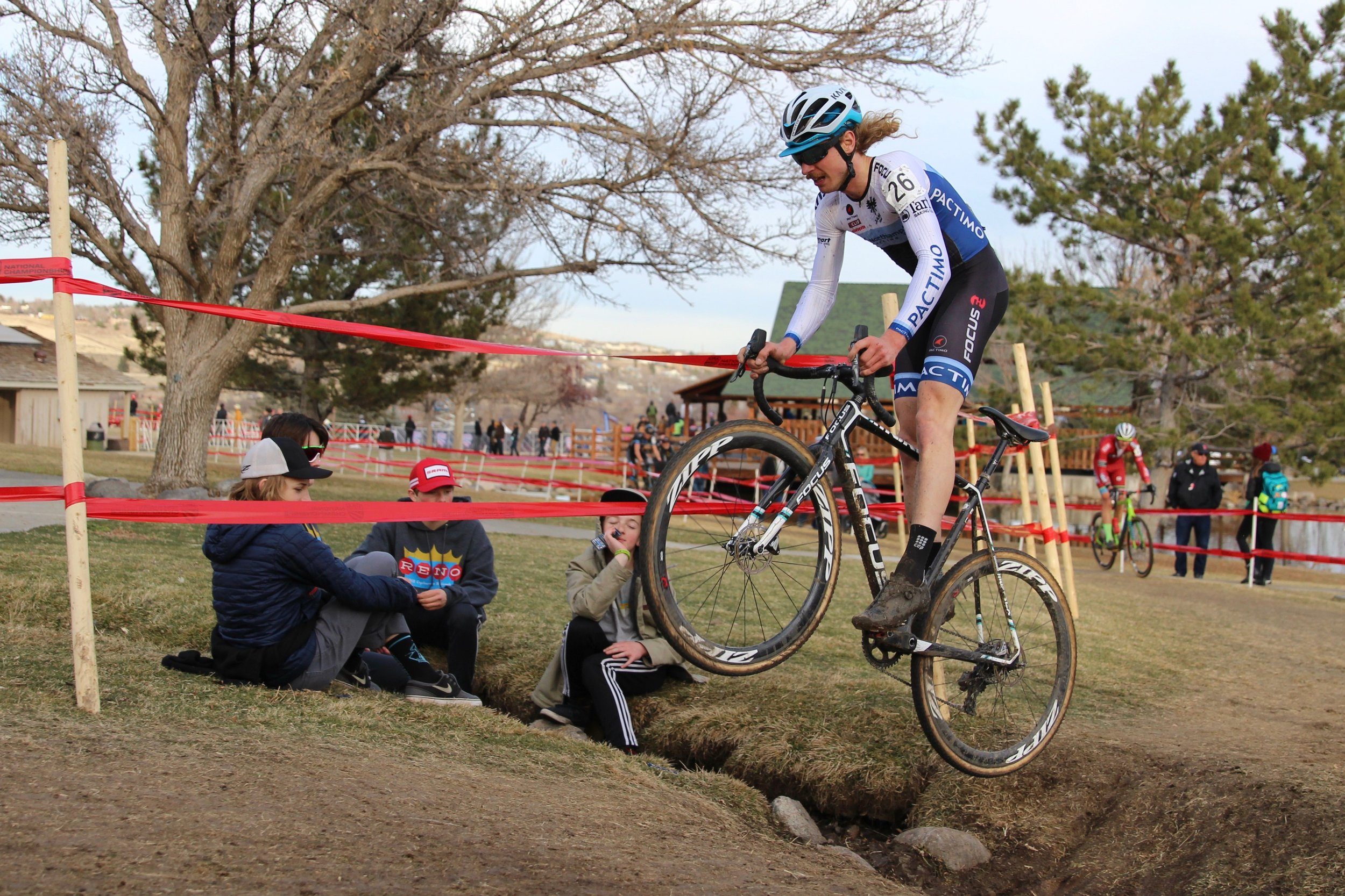 Smith jumps over the tricky ditch during Cyclocross National Championships in Reno, Nevada on Jan. 14, 2018. Photo by Vicky Sama.