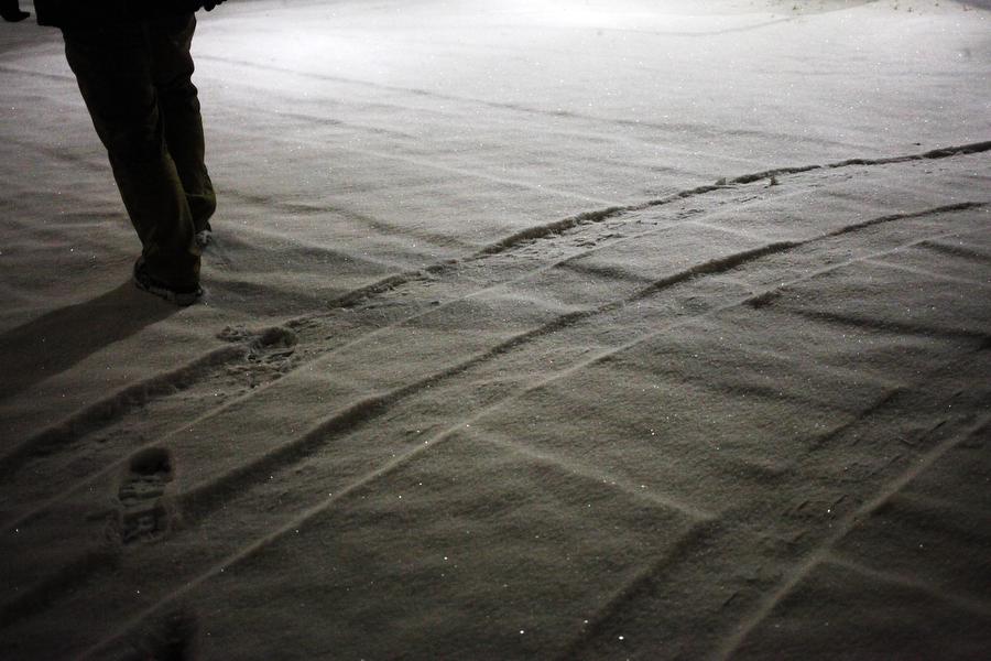 Pat Jarrett walks through the snow-covered cobblestone on Feb. 12, 2014, in Staunton.