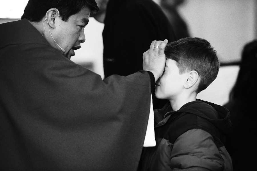 Fr. Rolo Castillo places ashes on a congregant's forehead during Ash Wednesday service on Wednesday, March 5, 2014, at St. John the Evangelist in Waynesboro. Ash Wednesday signifies the beginning of the Lenten season, the 40 days of reflection that lead up to Easter Sunday.
