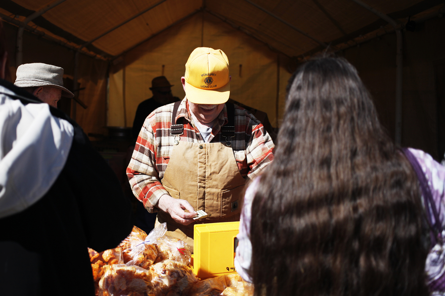Bill Ellenburg sells pork rinds with the Monterey Lions Club on Saturday, March 8, 2014, in front of the Highland County Public Schools during the Maple Festival in Monterey, Va.