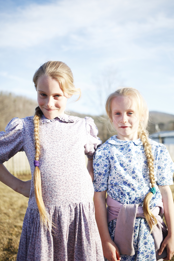 Sisters Jennifer, 9, and Rachel Hartzler, 7, behind the Sugar Tree Country Store on Saturday, March 8, 2014, during the Highland County Maple Festival in McDowell, Va. The two said they have never cut their hair.