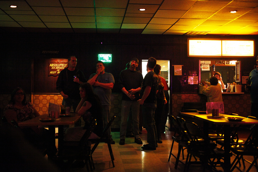 Patrons stand near the bar at Dice's in Staunton.
