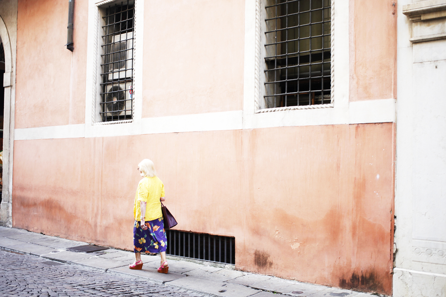 A woman walks through the streets of Vicenza on Friday, June 27 in the city center.