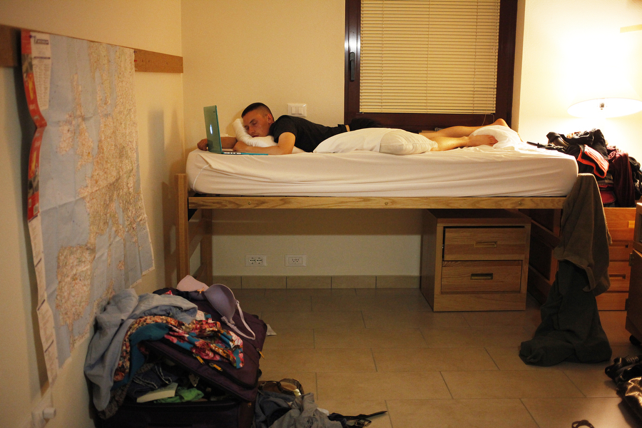 "Tyler falls asleep watching ""Adventure Time"" in his room in the barracks on Del Din on Friday, June 27, 2014, in Vicenza."