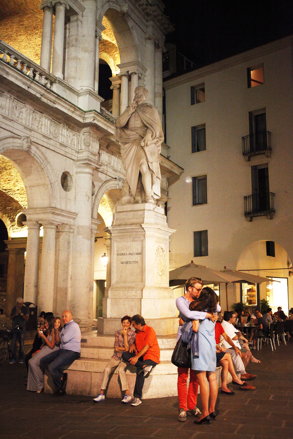 A couple embraces at the Piazza dei Signori in Vicenza, Italy.