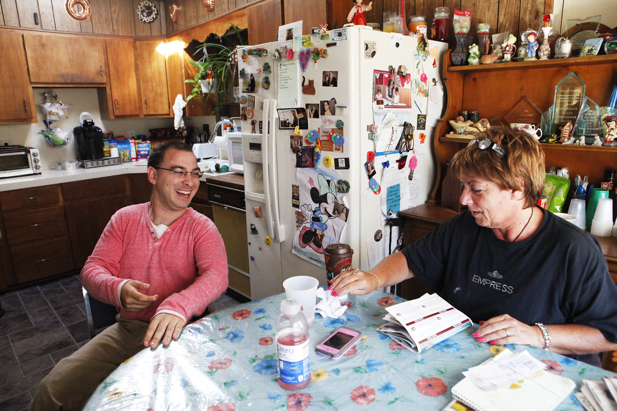 Lee has breakfast with his mother, Mona, in the morning on Sunday, Oct. 12, 2014, at his home in Kauneonga Lake, New York.