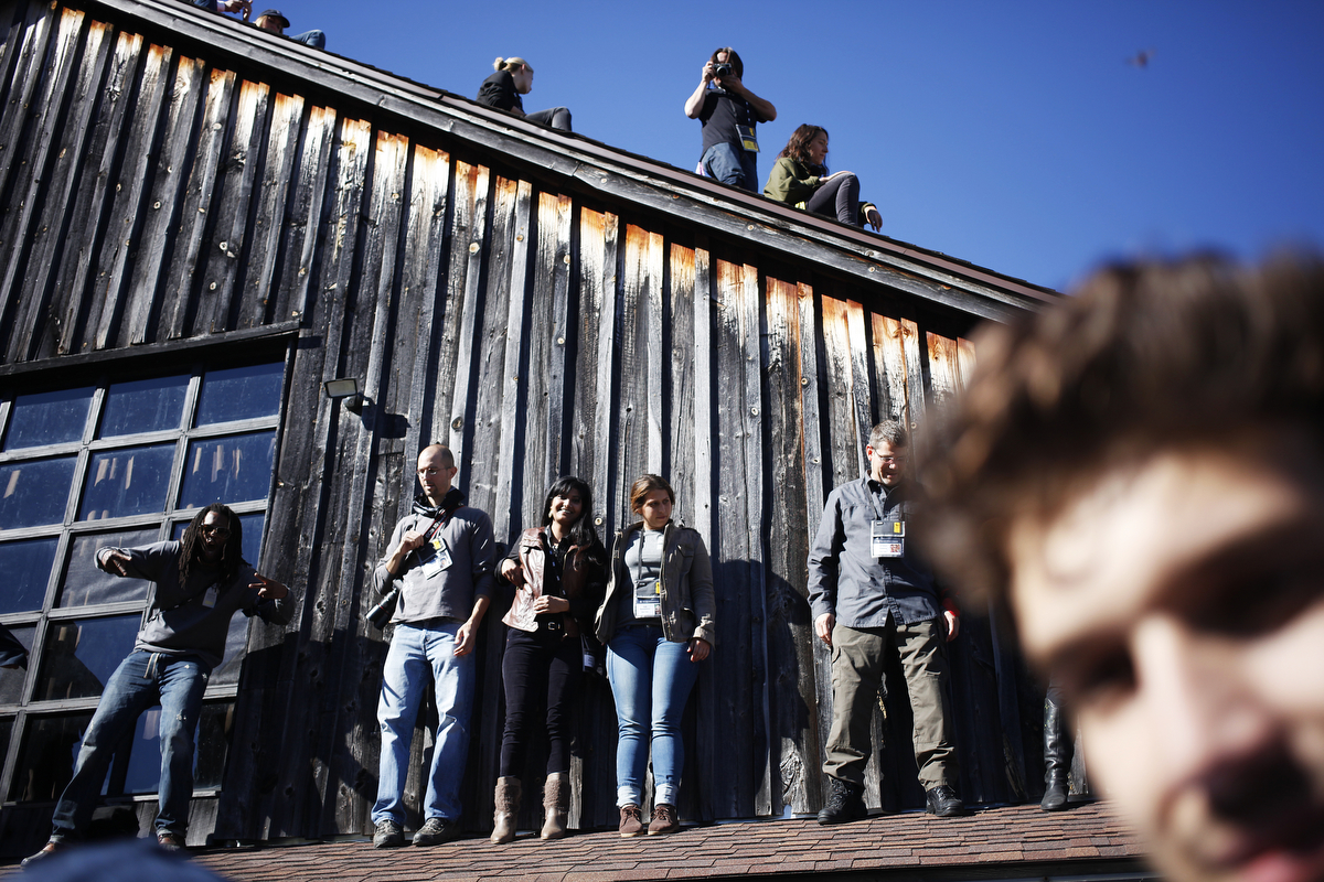 Students, members of the black team, faculty members and sponsors clamor on the barn for the group picture for the 27th Eddie Adams Workshop in Jeffersonville, New York.