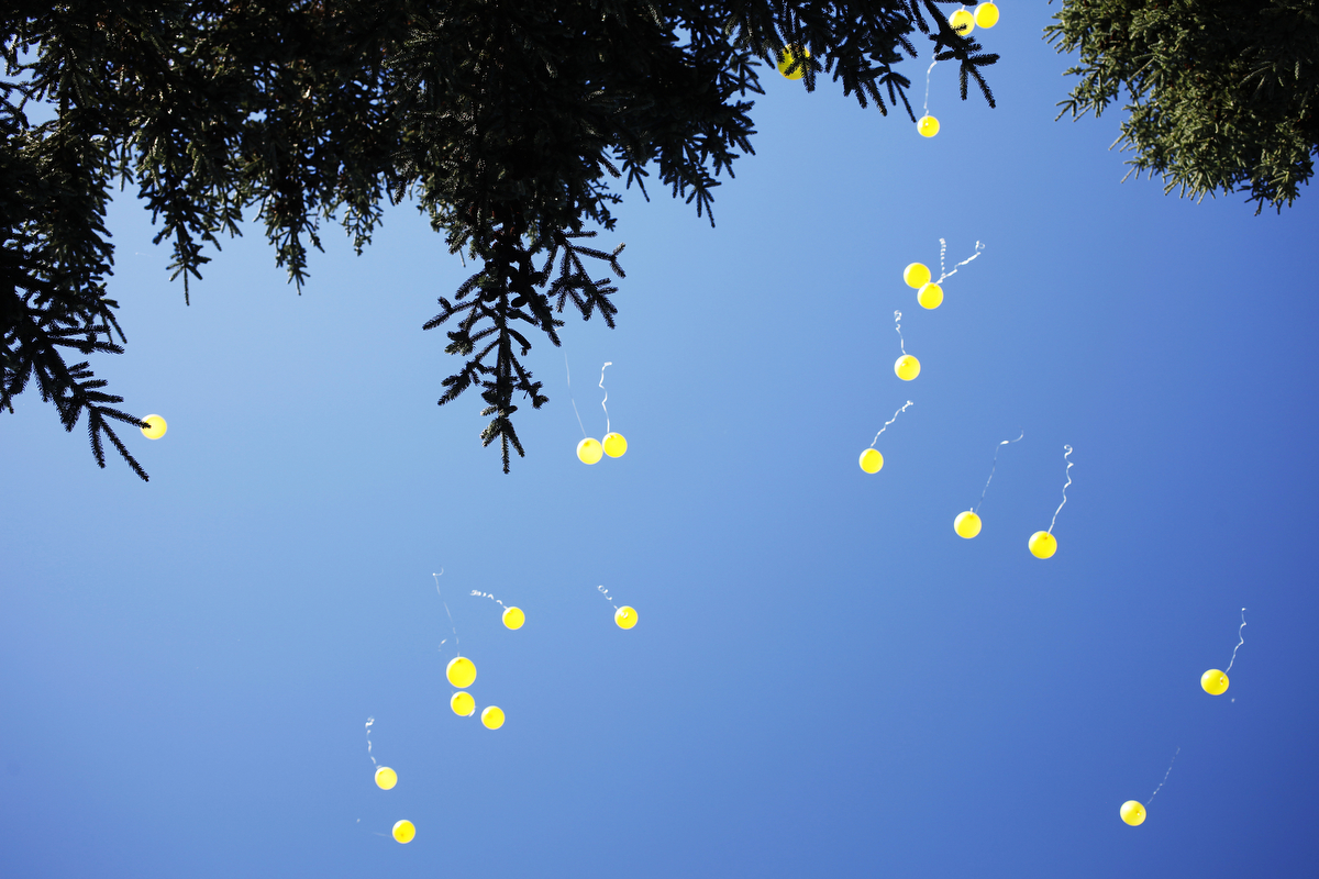 Yellow balloons take flight during the 27th Eddie Adams Workshop after a memorial service for war photographers who have died in combat.