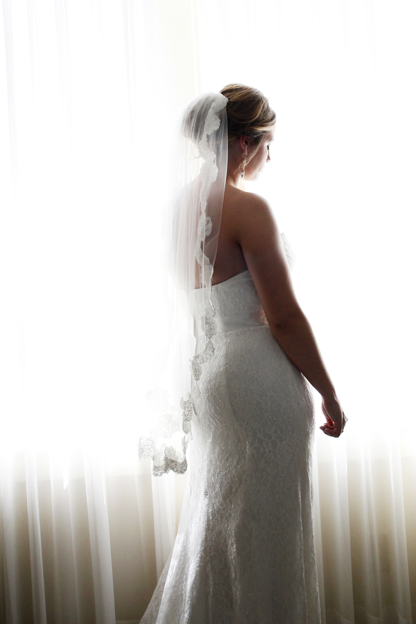 Jessica Martinez poses in front of the window of a room inside the Elms Hotel & Spa on her wedding day, Saturday, May 10, 2014, in Excelsior Springs, Mo.