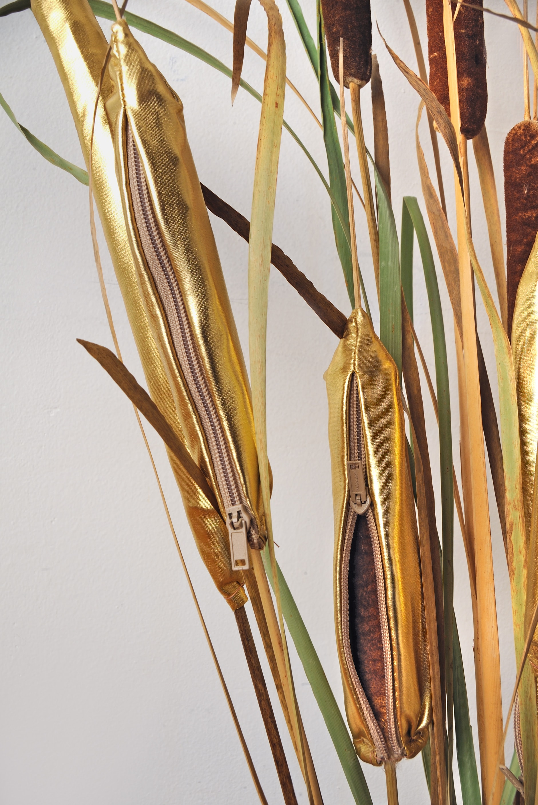 Golden Cattails   Cattail, gold lamé and zipper  Size Varies  $100 each   Click here to inquire .