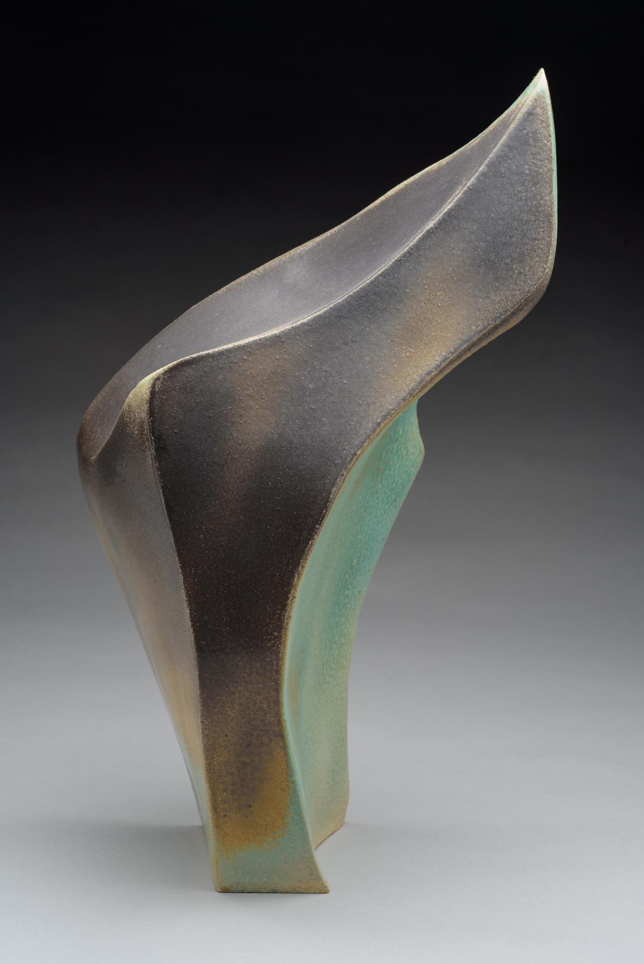 "Carbon Flame . Ceramic. Handbuilt from stoneware clay, sprayed glaze, salt/soda fired to cone 10 in Noborigama wood kiln. 19"" h x 8"" w x 9"" d. 2016."