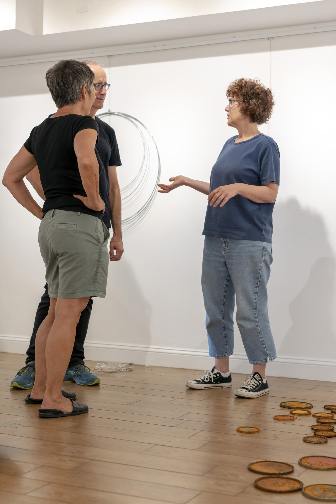 Studio Gallery artists Veronica Szalus and Pam Frederick, discussing installation