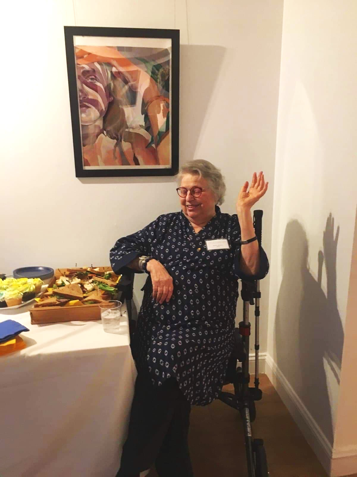 Barb at a Studio Gallery event, waving away compliments on her excellent food display.