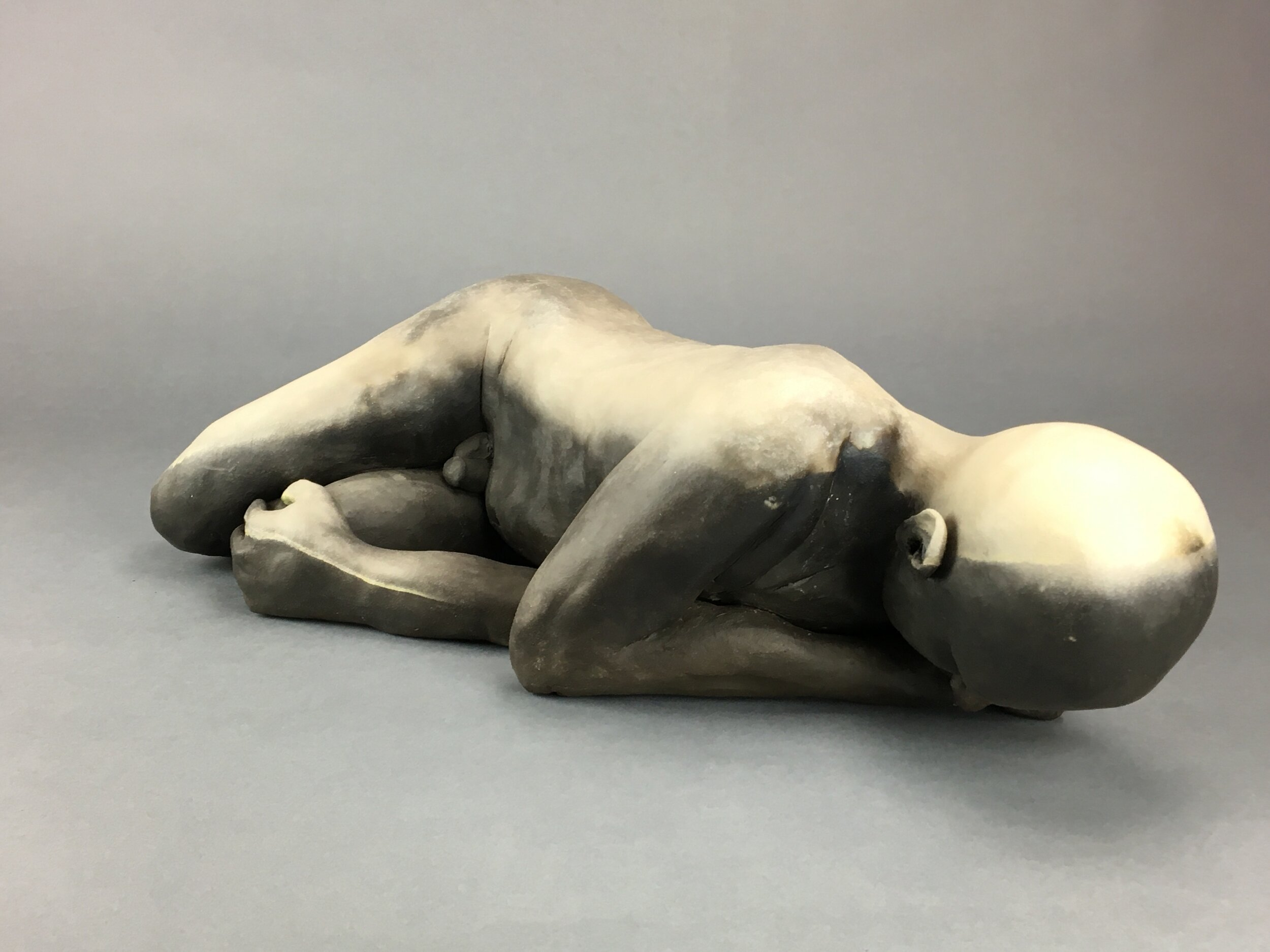 """And the Light and the Dark Came Back Together    Pit-fired ceramic  6"""" x 25"""" x 9""""  $3000  Click image to enlarge ⦿  Inquire"""