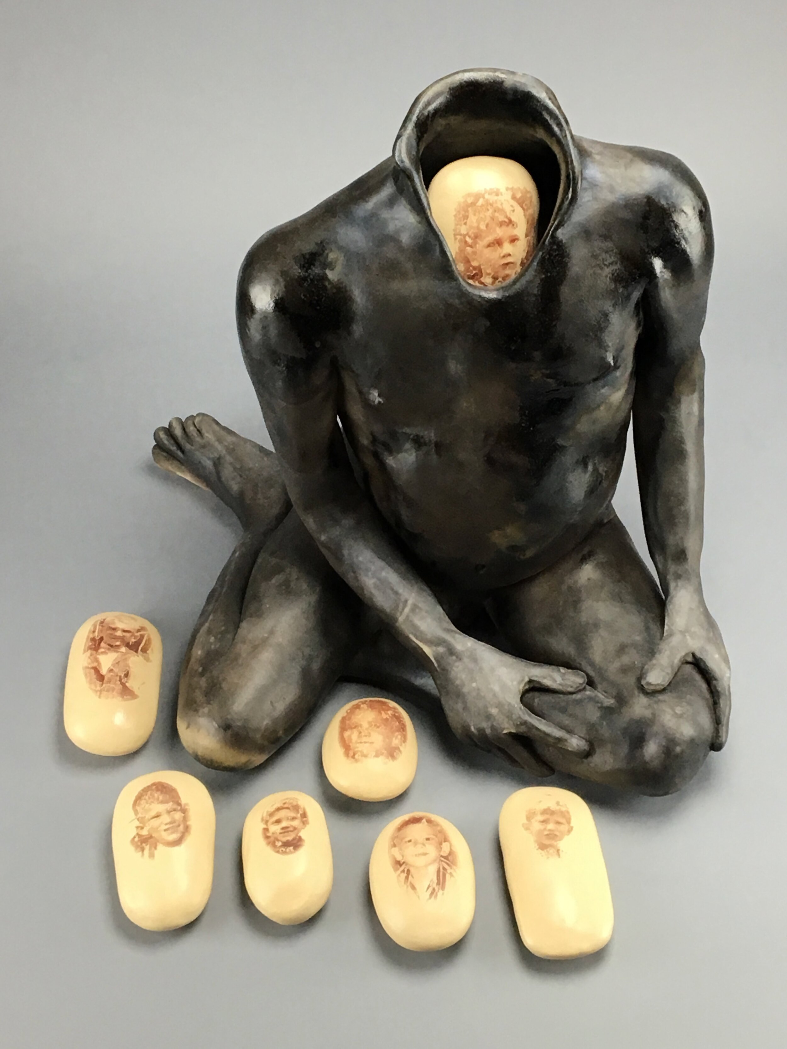 """Nest (with 7 eggs)    Figure: pit-fired ceramic; Eggs: ceramic, underglaze, image transfer  15"""" x 15"""" x 17""""  $4000  Click image to enlarge ⦿  Inquire"""