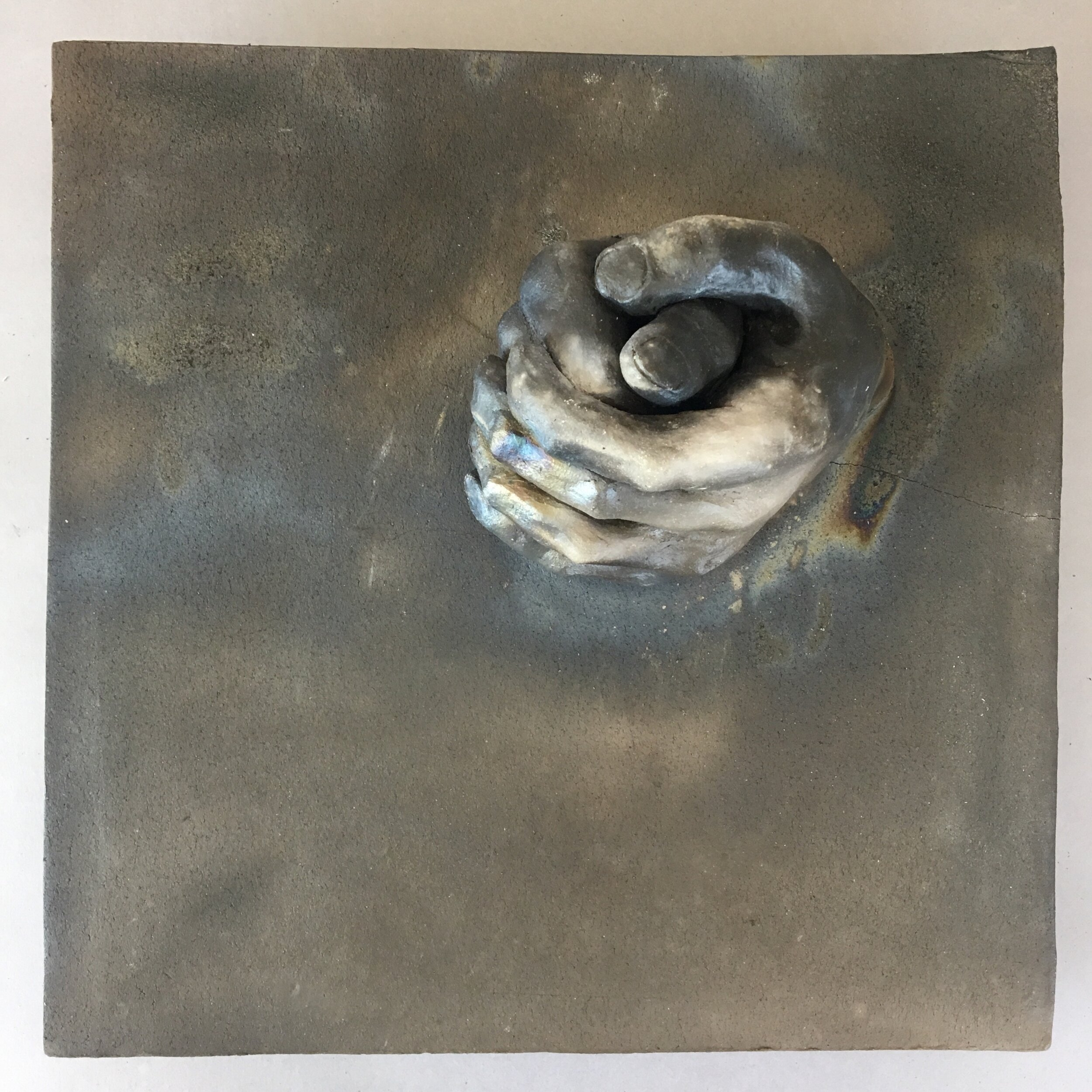 """Becoming  (panel 10 of 15)   Pit-fired ceramic on birch mounts  11.5"""" x 11.5"""" x variable thickness  Relief panels: $400 each  Flat panels: $75 each  Complete set: $4500  Click image to enlarge ⦿  Inquire"""