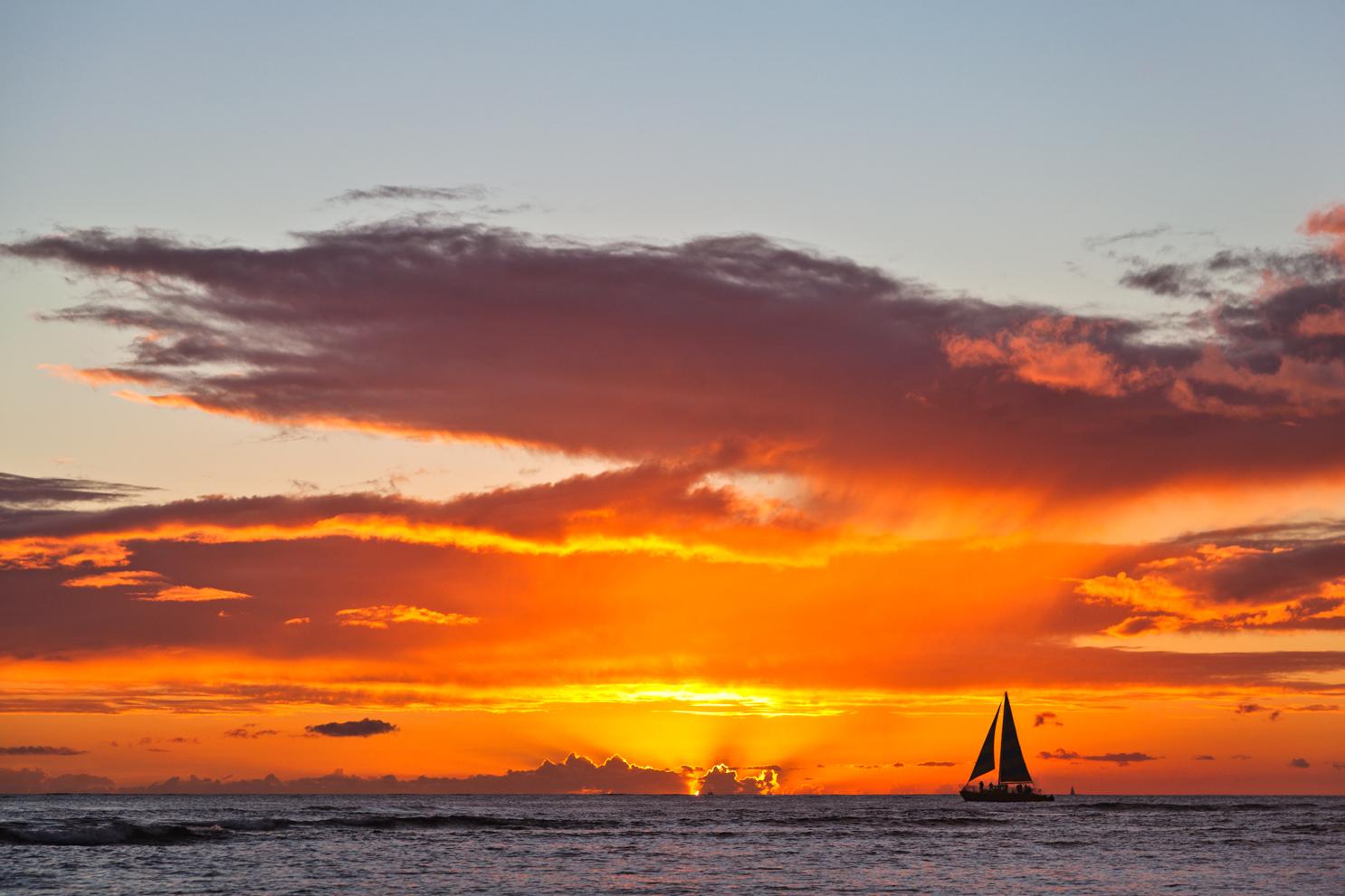 sailboat-on-the-horizon-at-sunset-travel-photographer.jpg