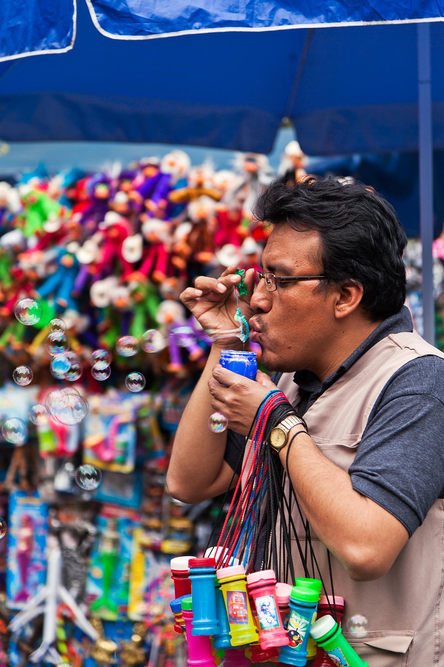 man blowing bubbles chapultepec park mexico city.jpg