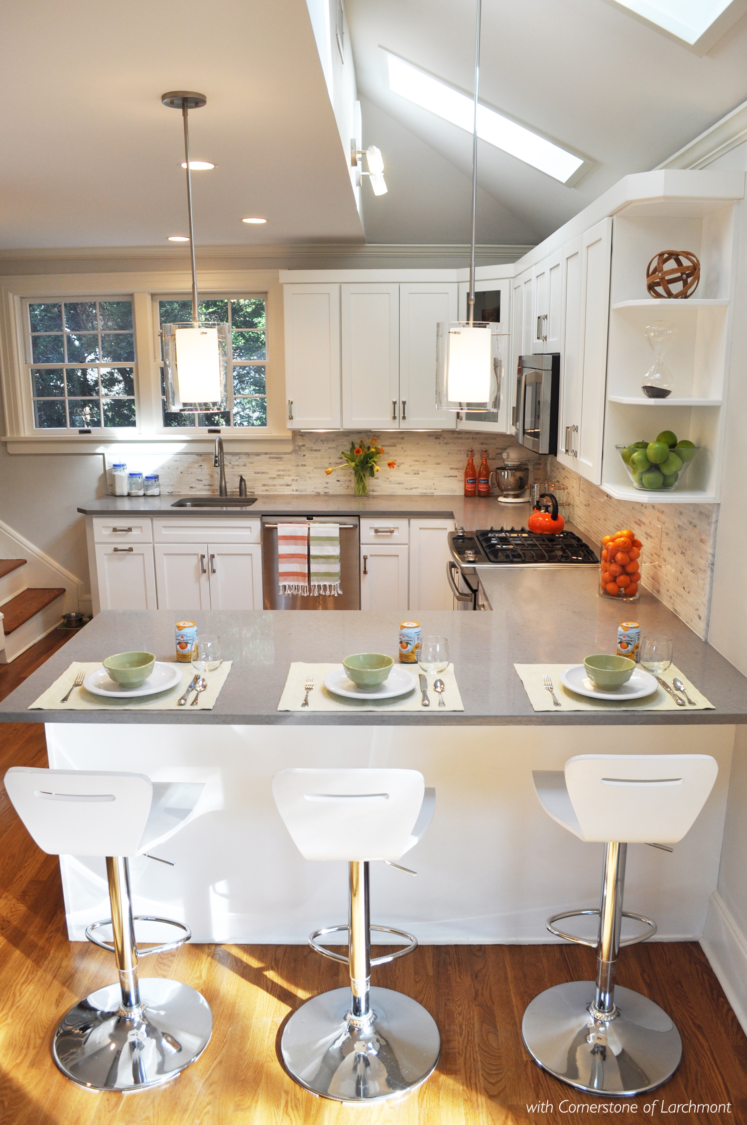 KAM DESIGN LLC_Kitchen Remodel_White Cabinets_Peninsula_Glass Pendants_Caesarstone.jpg