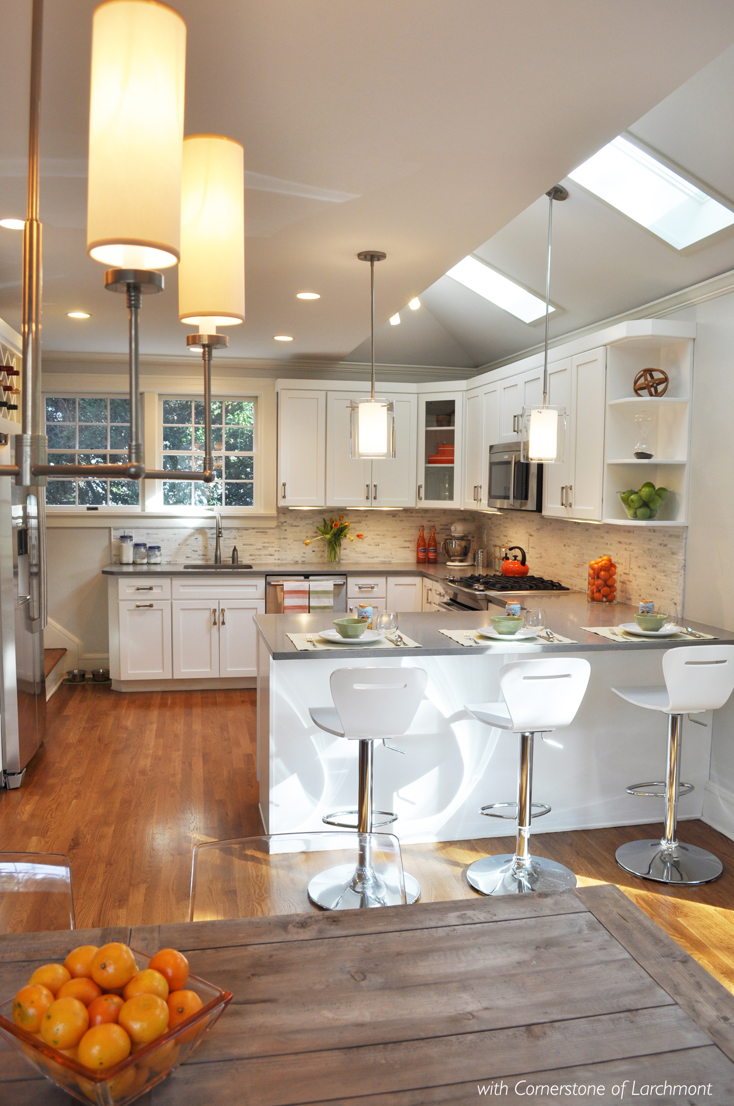 KAM DESIGN LLC_Kitchen Remodel_White Kitchen Cabinets_Caesarstone counters_Carrara Backsplash_Modern Lighting.jpg