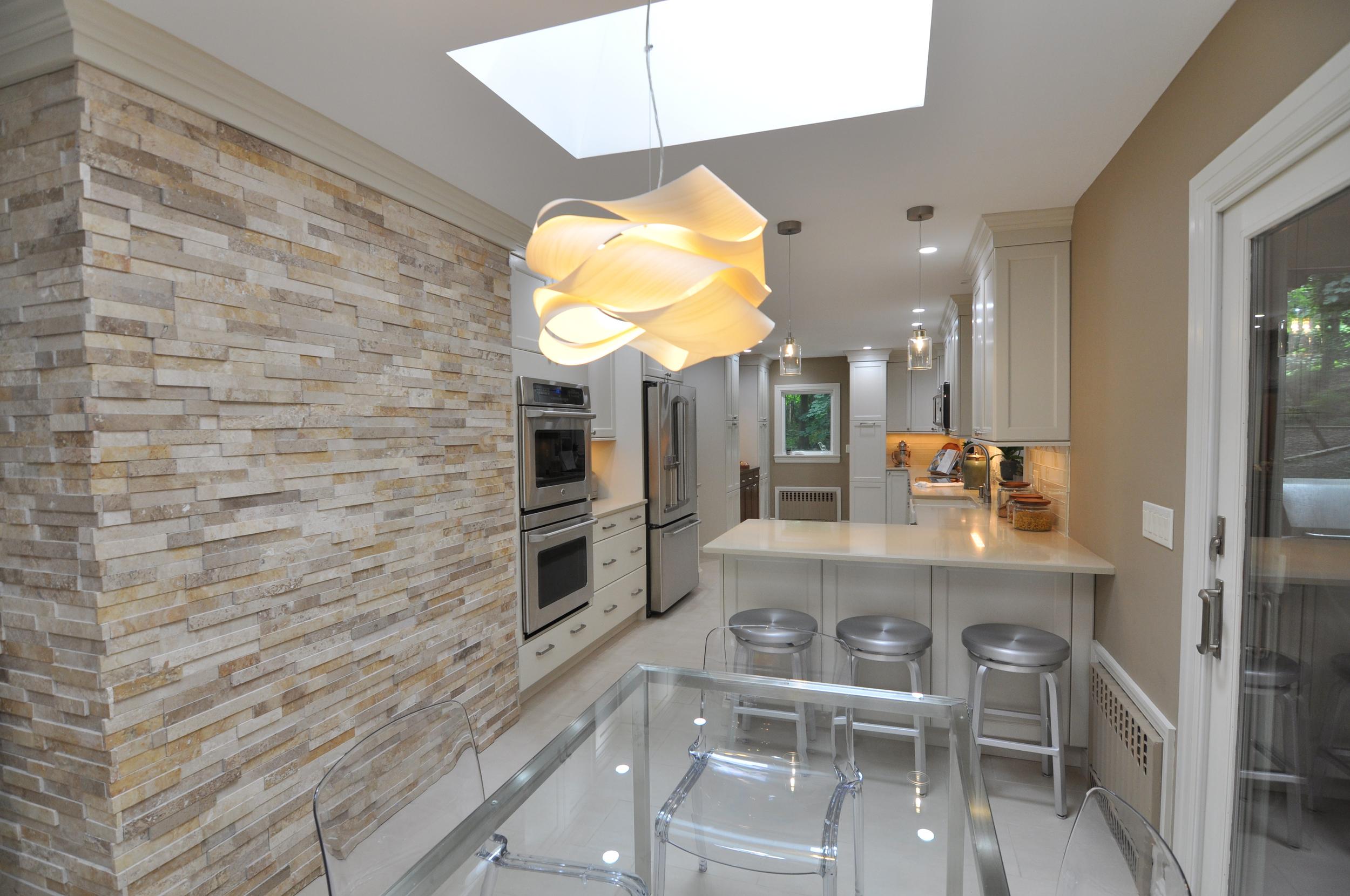 KAM DESIGN LLC_Kitchen Remodel Ideas_Kitchen Renovation Ideas_Modern Kitchen_Stone Interior Wall_Modern Kitchen Pendatns_White Kitchen Cabinets.jpg
