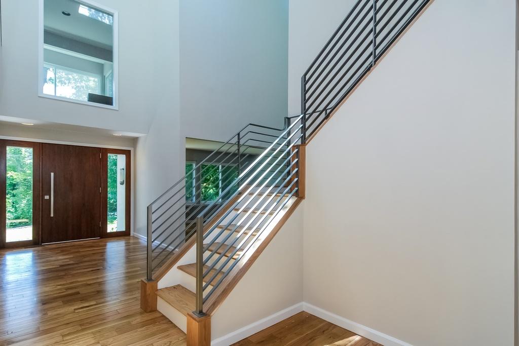 Foyer Iron Stair Railing_Front Door_KAM DESIGN.jpg