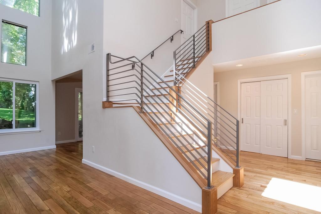 Foyer Custom Modern Iron Stair Railing_KAM DESIGN.jpg