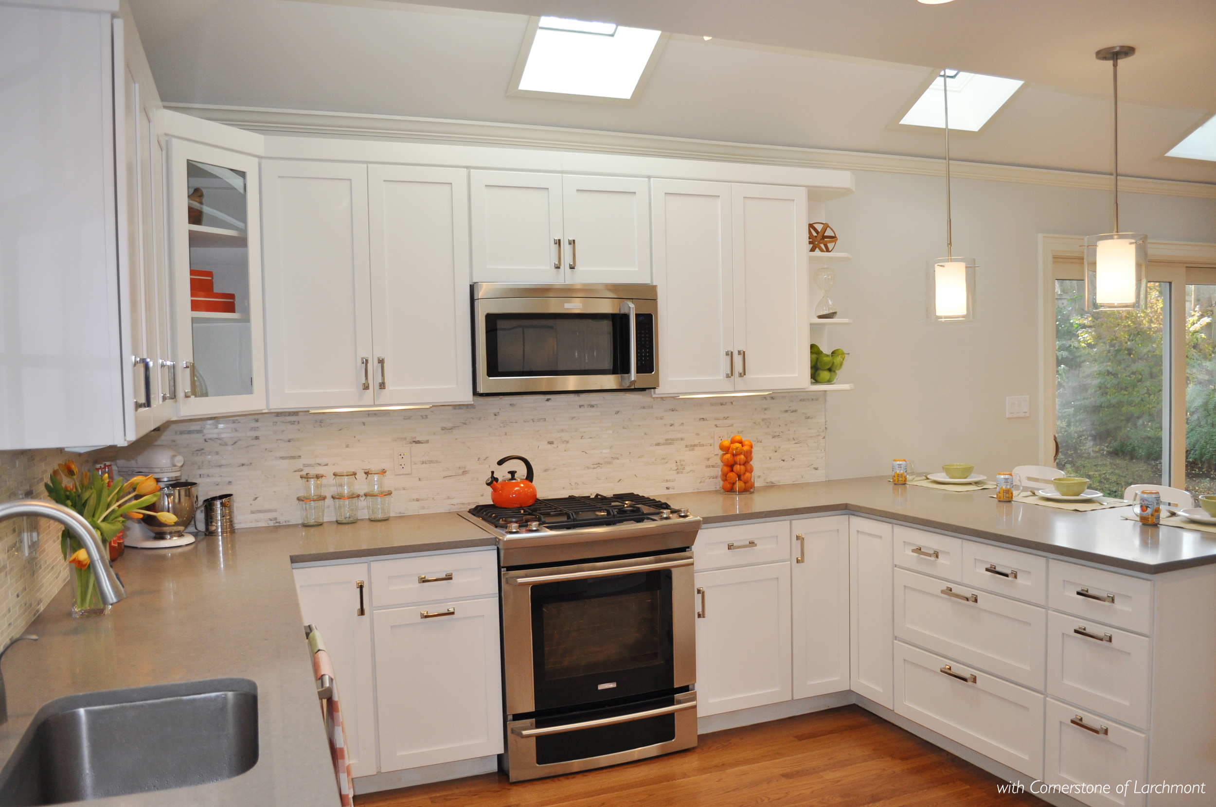 Kim Annick Mitchell_Interior Designer_Kitchen Remodel_White Kitchen Cabinetry_Grey Caesarstone Countertops_Kitchen Glass Clear Pendant Lights_Marble Backsplash Tile.jpg
