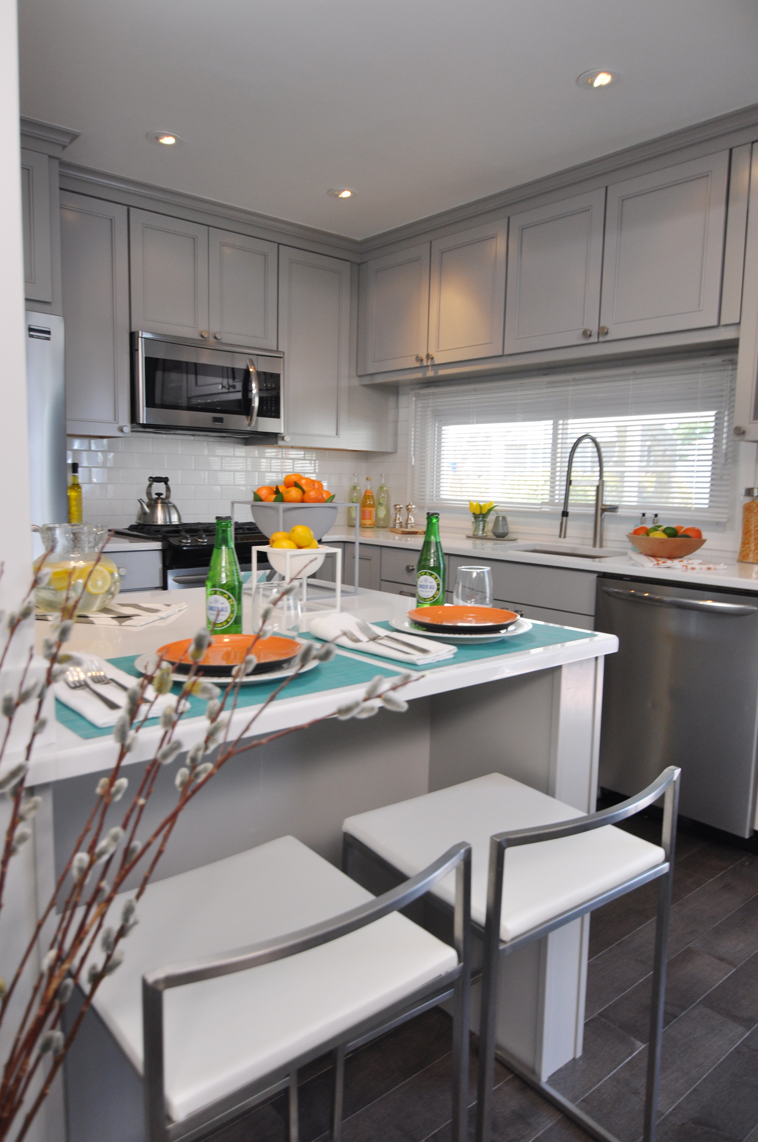 Kim Mitchell_Production Designer_HGTV_Buying and Selling with The Property Brothers_Kitchen Remodel_Grey Kitchen Cabinets_Kitchen Island_Grey Modern Kitchen.jpg